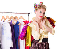 Pinup woman with shopping bags and hanger Royalty Free Stock Photo