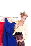 Pinup woman showing her dresses on hanger Royalty Free Stock Images