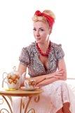 Pinup woman sitting at tea table Royalty Free Stock Image