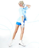 Pinup woman in winter style with skates. Royalty Free Stock Images