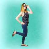 Pinup women in blue jeans Stock Photos