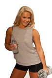 Pinup workout. Pretty blonde in work out gear, with bottled water and barbells Stock Image