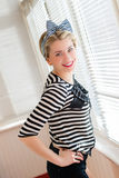 Pinup young woman having fun on the balcony. Closeup image of pinup girl beautiful blond young woman in striped blouse having fun happy smiling looking  in Stock Images
