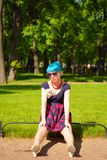 Pinup young woman witch blue hair in vintage style clothing in city park Stock Images