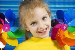 Pinwheel. Children with rainbow pinwheel on a striped blue background Royalty Free Stock Photo