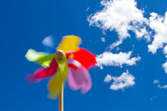Pinwheel on blue sky with white clouds Stock Photos