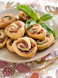 Pinwheel cookies. With prosciutto, basil and cheese, selective focus Stock Photos