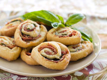 Pinwheel cookies. With prosciutto, basil and cheese, selective focus Royalty Free Stock Photo