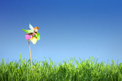Pinwheel on the grass. Under the blue sky Stock Photo