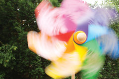 Pinwheel in motion. Against nature background Royalty Free Stock Photo