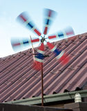 Pinwheel in the national colors spins in the wind Stock Photo