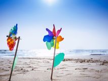 Pinwheel on sand Beach Outdoor Summer holiday background Royalty Free Stock Images