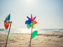 Pinwheel on sand Beach Summer Holiday background outdoor Stock Images