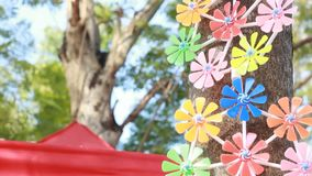 Pinwheel spinning during wind come. It still on tree. Camera looking up tilt smooth moving. stock footage