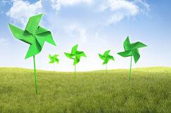 Pinwheel windmills in a field of grass Royalty Free Stock Image