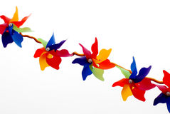 Pinwheels. A string of plastic colored pinwheels Stock Photos