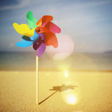 Pinwheels On The Beach Blowing Sunshine Concept Stock Images