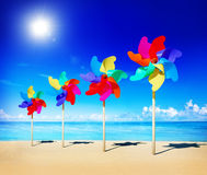 Pinwheels On The Beach Blowing Sunshine Concept.  Royalty Free Stock Images