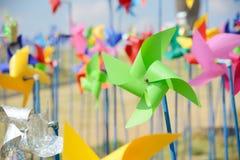 Pinwheels. Closeup of pinwheel in many other colorful pinwheels Royalty Free Stock Images