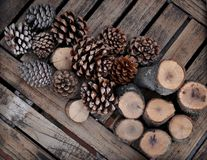 Pinyon pine cones and diagonal timbers Royalty Free Stock Photography