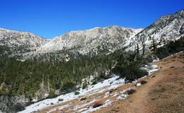 Pinyon Ridge Trail. Snow-covered mountains, sky and trees, California Stock Photos