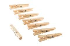 Pinzas de madera con el cambio Foto de archivo