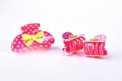 Pinzas de pelo plásticas rosadas Fotografía de archivo libre de regalías