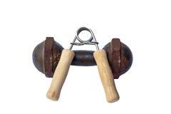 Pinze di presa della mano e teste di legno del ferro Fotografie Stock