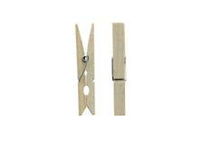Pioli di legno del panno isolati su fondo bianco Fotografia Stock