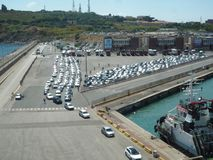 Piombino, 5 August 2016, Italy: line of cars ready to embark on a ferry boat stock image