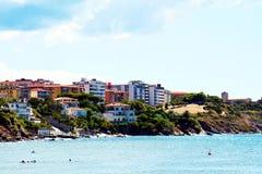 Piombino, Salivoli, Livorno, boats, rocks, roofs and tyrrhenian sea Royalty Free Stock Images
