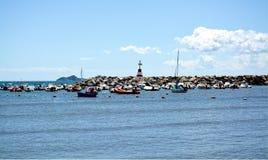 Piombino, Salivoli, Livorno, boats, rocks and tyrrhenian sea Royalty Free Stock Photos