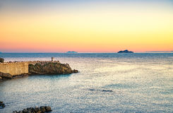 Piombino twilight panoramic view on piazza bovio lighthouse and Stock Images