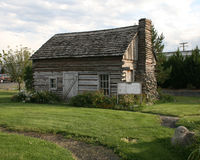 Pioneer Cabin. An early cabin with a stone and wood chimney Stock Photos