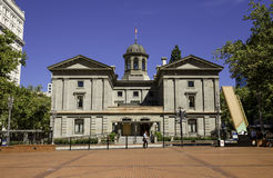 Pioneer Courthouse, pedestrian walking in front, Portland, Oregon, USA 7/5/2015 stock photo