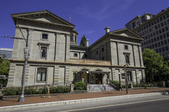 Pioneer Courthouse, pedestrian walking in front, Portland, Oregon, USA 7/5/2015 Royalty Free Stock Photography