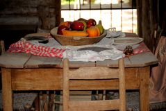 Pioneer Dining. An old dining table from the 1800s Royalty Free Stock Photo