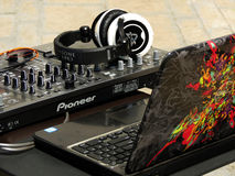 Pioneer DJ set with Dell laptop outdoors. DJ set with mixer, headset and sunglasses with colorful laptop, this is one of very popular combinations amongst DJs Royalty Free Stock Photography