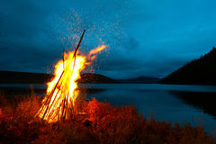 Pioneer fire. Pioneer night bonfire on the beach of the lake Stock Image