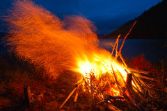 Pioneer fire. Pioneer night bonfire on the beach of the lake Stock Photos