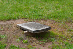 A pioneer headstone that has been vandalized by breaking it off of its base Stock Photography
