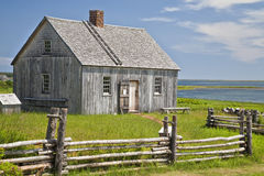 Pioneer House. An example of an early pioneer homestead circa 1700 in rural Prince Edward Island, Canada. An early Acadian home originally known as the Doucette stock images