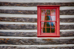 Log Cabin. A closeup of a weathered century log home sagging in the middle Stock Photos