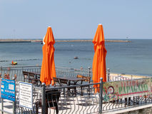 PIONEER, RUSSIA.Two beach orange umbrellas against the background of the Baltic Sea Stock Images