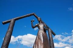 Pioneer School Teacher. Monument statue of a Pioneer School Teacher ringing a bell in Steilacoom, Washington royalty free stock photos