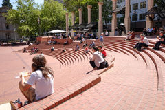 Pioneer Square on a sunny spring day. Portland, Oregon, May 6, 2016: People lounge on brick steps in Pioneer Square at lunchtime on a sunny day Royalty Free Stock Photos