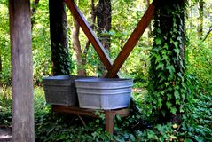 Pioneer Style Wash tubs. Pioneer style wash shed with wash tubs surrounded by nature Stock Image