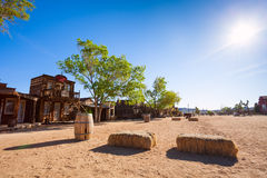 Pioneer town buildings and hay stack on the street Stock Photo