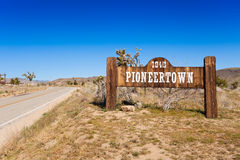 Pioneer town sign on the road Stock Photos