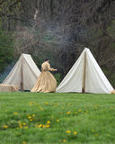 Pioneer woman near her tent. Pioneer woman reenactment of civil war era Stock Photography